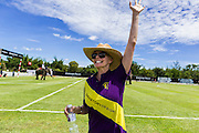 "29 AUGUST 2013 - HUA HIN, PRACHUAP KHIRI KHAN, THAILAND: SARA STORY cheers her team, Sara Story Design on to victory in their game against the Citibank team in King's Cup Elephant Polo Tournament in Hua Hin. The tournament's primary sponsor in Anantara Resorts and the tournament is hosted by Anantara Hua Hin. This is the 12th year for the King's Cup Elephant Polo Tournament. The sport of elephant polo started in Nepal in 1982. Proceeds from the King's Cup tournament goes to help rehabilitate elephants rescued from abuse. Each team has three players and three elephants. Matches take place on a pitch (field) 80 meters by 48 meters using standard polo balls. The game is divided into two 7 minute ""chukkas"" or halves. There are 16 teams in this year's tournament, including one team of transgendered ""ladyboys.""    PHOTO BY JACK KURTZ"