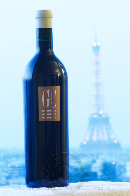 GC Grand Cru from Chateau du Cedre against a background in pale blue with a view over Paris and the Eiffel Tower illuminated Cahors Lot Valley France