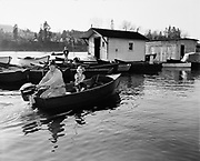 """Y-510406-01.  """"Del Akin, 1316 NE 53rd, and Diane, age 7, starting out salmon fishing from Sportscraft Landing, Oregon City."""" April 6, 1951"""