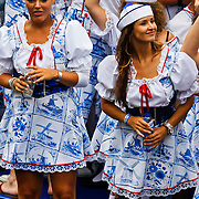 NLD/Amsterdam/20100807 - Boten tijdens de Canal Parade 2010 door de Amsterdamse grachten. De jaarlijkse boottocht sluit traditiegetrouw de Gay Pride af. Thema van de botenparade was dit jaar Celebrate, BNN boot,