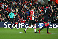 Football - 2017 / 2018 Premier League - Southampton vs. Huddersfield Town<br /> <br /> Referee Mr Lee Probert laughs after Scott Malone of Huddersfield Town (no3) blasted the ball into the face of his team mate Laurent Depoitre of Huddersfield Town at St Mary's Stadium Southampton<br /> <br /> COLORSPORT/SHAUN BOGGUST