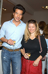 SOPHIA SWIRE and ANDREAS LIM at a party to launch the Acqualuna jewellery exhibition at Allegra Hicks, 28 Cadogan Place, London on 22nd June 2005.<br /><br />NON EXCLUSIVE - WORLD RIGHTS