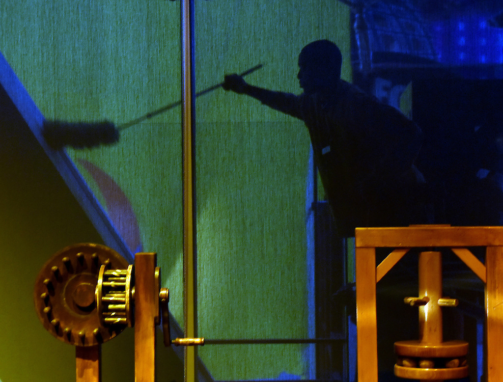 Mara Lavitt -- Special to the Hartford Courant<br /> February 3, 2016<br /> Connecticut Science Center (Hartford) James Josey of New Britain, a visitors services and facilities staffer, is seen in silhouette through a shaded window in the Leonardo da Vinci: Machines in Motion exhibit as he dusts a glass side wall.