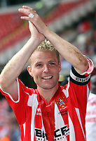 Photo: Rich Eaton.<br /> <br /> Grimsby Town v Cheltenham Town. Coca Cola League 2. Play off Final. 28/05/2006. Cheltenham captain celebrates promotion to league 1 at the end of the game