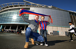 Crystal Palace fans pose with a scarf outside the stadium prior to the match