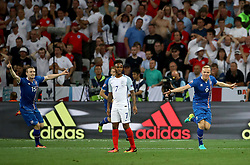 File photo dated 27-06-2016 of Iceland's Kolbeinn Sigthorsson (right) celebrating scoring his side's second goal as England's Raheem Sterling stands dejected during the Round of 16 match at Stade de Nice, France. Issue date: Tuesday June 1, 2021.