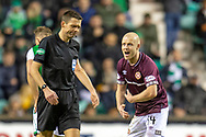 Steven Naismith (#14) of Heart of Midlothian shouts at refree Kevin Clancy during the Ladbrokes Scottish Premiership match between Hibernian FC and Heart of Midlothian FC at Easter Road Stadium, Edinburgh, Scotland on 29 December 2018.