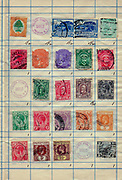 A collection of old stamps from Southern Rhodesia, the Union of South Africa, South Australia, and the Straits Settlements. Philately is the study of postage stamps and postal history.