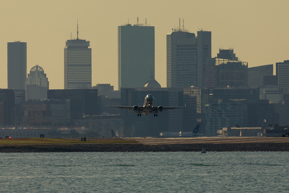 A jetliner lifting off from Logan International Airport in Boston.