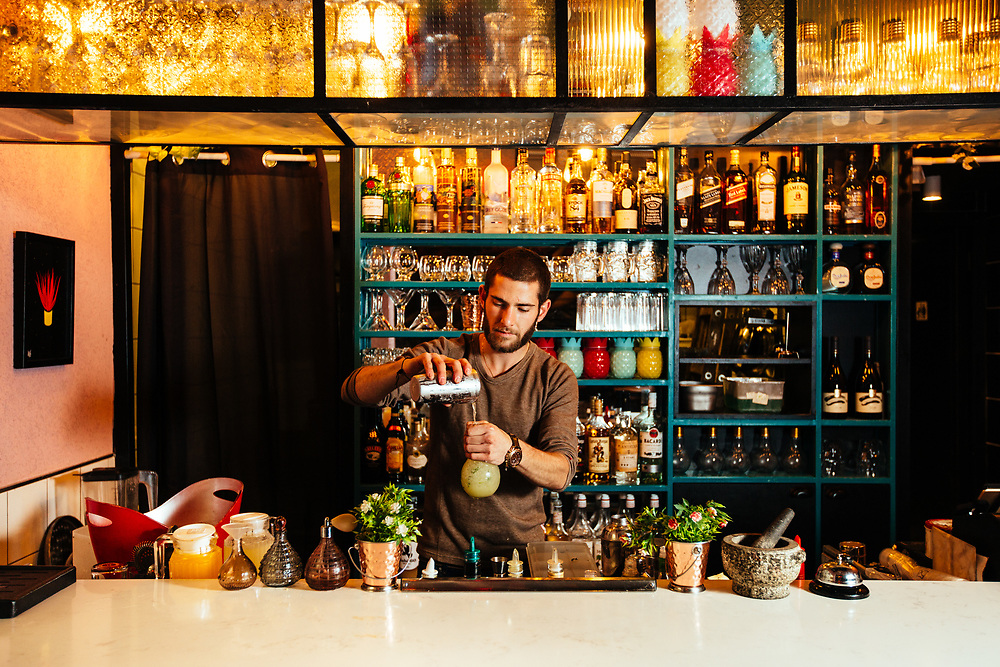 Bartender and co-owner Gil Barnea preparing the To Be or Not To Be cocktail at Tap & Tail bar at the heart of Mahane Yehuda Market, often called 'The Shuk'  in Jerusalem, Israel, on November 21, 2017.