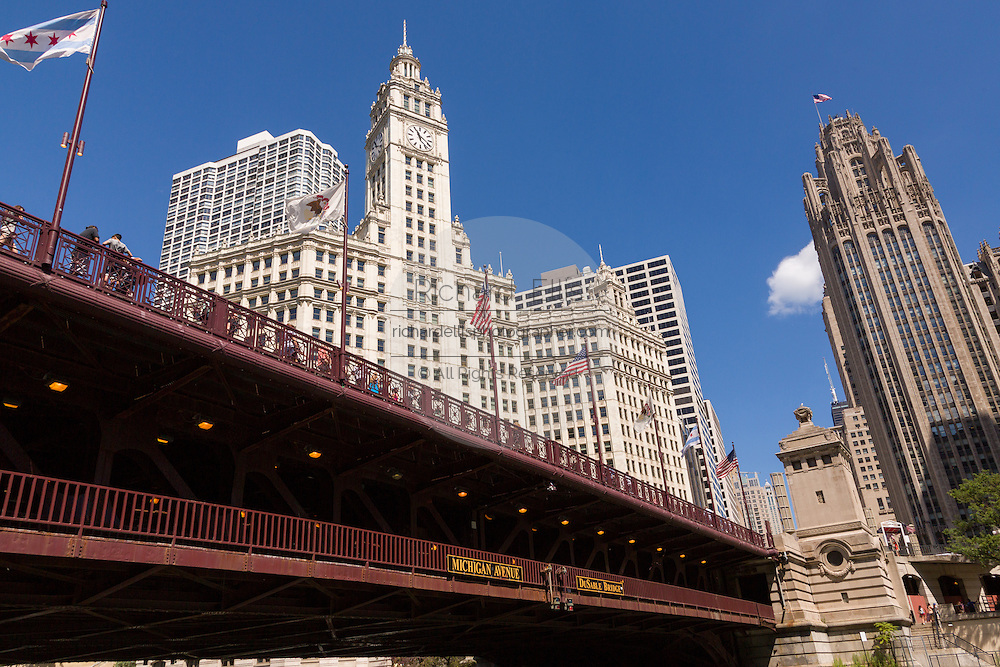 Wrigley Building and Tribune Tower with the DuSable Bridge viewed from Riverwalk on a summers day in Chicago, Illinois, USA