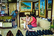 Palma de Mallorca, Mallorca, Mallorca is just as Italy known for its shoes. Through the window I see how at Calzados Melchor the family enjoys how the newborn baby reacts on the father. Shoes and tableaux of Mallorca for sale