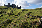 A group of adults and children walk up the steep incline towards Carreg Cennen Castle which sits at the top of a limestone cliff on 18th February 2019 in Trapp, Powys, Wales, United Kingdom. The castle has been in a ruinous state since 1462 and is under the care of Cadw, the Welsh Government historic environment service, however the estate is used as working farm land.