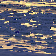 Ice formations on frozen Churchill, Manitoba. Canada. Evening.