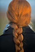 Back of a girls head with red plaited hair in Hampstead, London, United Kingdom.