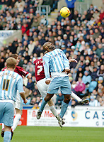 Photo: Kevin Poolman.<br />Coventry City v Burnley. Coca Cola Championship. 25/02/2006. <br />Coventry's Dele Adebola beats James O'Connor in the air.
