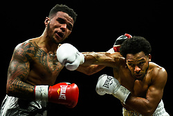 April 13, 2018 - Minnesapolis, MN, USA - Haskell Rhodes, right, of Las Vegas, connects with a right hook to Mike Fowler, of Milwaukee, during their lightweight match at the Armory in Minneapolis on Friday, April 13, 2018. (Credit Image: © Aaron Lavinsky/TNS via ZUMA Wire)
