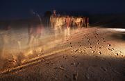 Pleistocene human footprints Australia: Willandra Lakes in southeastern Australia. Pathways photo illustration of the worlds largest Pleistocene Human footprints, in western NSW. Children from the three traditional tribal groups of the Willandra Lakes walk on the site of what promises to be the world's largest collection of Pleistocene human footprints in the world.