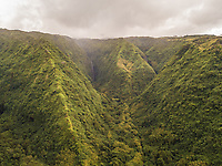 Aerial view of Tahiti mountains with stormy weather in French Polynesia.