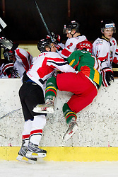 Marius Gohringer of Austria vs Sarunas Suchomlinas of Lithuania   during the ice hockey match between National teams of Lithuania (LTU) and Austria (AUT) at 2011 IIHF World U20 Championship Division I - Group B, on December 12, 2010 in Ice skating Arena, Bled, Slovenia.  (Photo By Vid Ponikvar / Sportida.com)
