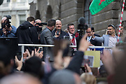 The flags of right-wing supporters of the anti-Islam activist Tommy Robinson real name Stephen Yaxley-Lennon and former leader of the now-banned English Defence League listen to his witness statement after being freed on bail outside the Central Criminal Court The Old Bailey, on 23rd October 2018, in London, England. Around a thousand gathered in the street specially cordoned off by City of London police as Robinson appeared before Nicholas Hilliard, the recorder of London, for a contempt hearing at the Old Bailey during which he was again bailed before the case was referred to the attorney general.