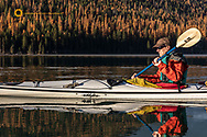 Sea kayaking on Bowman Lake in autumn in Glacier National Park, Montana, USA model released