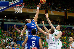 Joakim Noah of France vs Rimantas Kaukenas of Lithuania and Martynas Pocius of Lithuania during basketball game between National basketball teams of Lithuania and France at FIBA Europe Eurobasket Lithuania 2011, on September 9, 2011, in Siemens Arena,  Vilnius, Lithuania.  (Photo by Vid Ponikvar / Sportida)