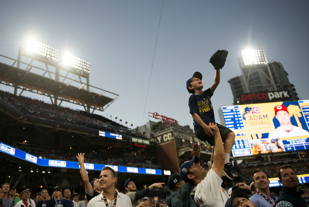 Joseph Castagnola, of San Diego, lifts up his son Luke, 8, looking for a baseball during the 2016 MLB All-Star Game at Petco Park in San Diego on Tuesday.<br /> <br /> ///ADDITIONAL INFO:   <br /> <br /> allstar.0713.kjs  ---  Photo by KEVIN SULLIVAN / Orange County Register  -- 7/12/16<br /> <br /> The 2016 MLB All-Star Game at Petco Park in San Diego.