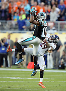 Carolina Panthers wide receiver Devin Funchess (17) leaps and catches a late second quarter pass for a gain of 24 yards to the Panthers 41 yard line while defended by Denver Broncos free safety Bradley Roby (29) during the NFL Super Bowl 50 football game against the Denver Broncos on Sunday, Feb. 7, 2016 in Santa Clara, Calif. The Broncos won the game 24-10. (©Paul Anthony Spinelli)