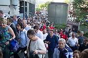 London, UK. Thursday 9th July 2015. Tube and train strikes caused misery for commuters with the entire London Underground network shut down and many rail services cancelled. The strike was in protest at longer working hours announced due to the tube system being open all night on weekends. Crowds of people pour into Waterloo mainline station.