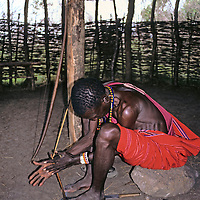 Africa, Kenya, Maasai Mara. Demonstration of starting a fire.