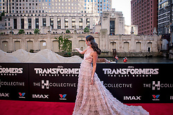 Laura Haddock gestures at a passing barge at the US Premier of 'Transformers: The Last Knight' on the Chicago River in front of the Civic Opera House on Tuesday June 20, 2017 in Chicago, IL. Photo: Christopher Dilts / Sipa USA *** Please Use Credit from Credit Field ***