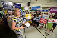 Television news anchor Ybeth Bruzual emcees the West Orange Chamber of Commerce's political Hob Nob and Straw Poll in Ocoee, Fla., Thursday, August 4, 2016. (Phelan M. Ebenhack via AP)