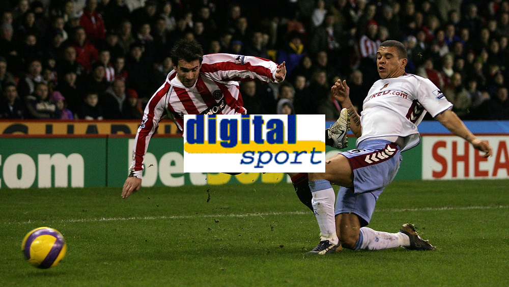 Photo: Paul Thomas.<br /> Sheffield United v Aston Villa. The Barclays Premiership. 11/12/2006.<br /> <br /> Wilfred Bouma (R) of Villa gets in and tackles Keith Gillespie before he can cross.