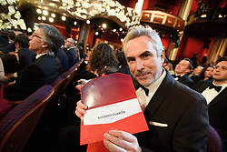 Alfonso Cuarón poses with the winning envelope for achievement in cinematography during the live ABC Telecast of the 91st Oscars® at the Dolby® Theatre in Hollywood, CA on Sunday, February 24, 2019.