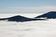 A phenomenal temperature inversion in North Wales, leaving only the summits of Snowdonia's highest peaks in glaring sunshine above the cloud bank.  <br /> <br /> Nantlle Ridge peaking above a vast sea of fog in brillian sunshine. Below. it seemed like an awful dull wet day.