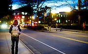 While many in Greensboro are getting their eight hours of sleep, campus is still humming.  There's more than studying going on. A UNCG student walks down Spring Garden street.