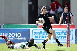 Tim Mikkelson scores a try for New Zealand during the XIX Commonwealth Games 7s rugby match between New Zealand and Guyana held at The Delhi University in New Delhi, India on the  11 October 2010..Photo by:  Ron Gaunt/photosport.co.nz