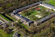 Nederland, Drenthe, Gemeente Noordenveld, 01-05-2013; gevangenisdorp Veenhuizen, gesticht door de Maatschappij van Weldadigheid voor bedelaars en landlopers.<br /> Esserheem, Huis van Bewaring voor vreemdelingen in strafrecht. Onderdeel van Penitentiaire Inrichting (PI) Veenhuizen. <br /> Veenhuizen prison village, founded in 1823 by the Benevolent Society for the rehabilitation of beggars and vagrants.<br /> Esserheem, detention center for foreigners. Part of Penitentiary Institute (PI) Veenhuizen.<br /> luchtfoto (toeslag op standard tarieven)<br /> aerial photo (additional fee required)<br /> copyright foto/photo Siebe Swart