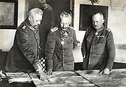 Wilhelm II Germany, centre, in the German High Command Headquarters with Field Marshal Paul von Hindenburg (left) and Quartermaster General Erich Ludendorff in January 1919.