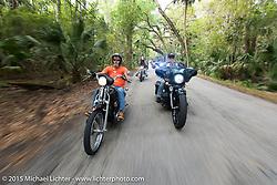 Bill Angel (R) of Kernersville, NC riding his 2010 Custom Street Glide through Tamoka State Park during Daytona Beach Bike Week 2015. FL, USA. March 13, 2015.  Photography ©2015 Michael Lichter.