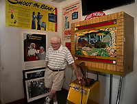 """Bob Lawton shares stories of how he acquired the """"Grandmother's Predictions"""" machine and others over the years for Funspot at Weirs Beach.  (Karen Bobotas/for the Laconia Daily Sun)"""