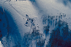 Aerial view of a oil and gas drilling rig in Wyoming in the snow.
