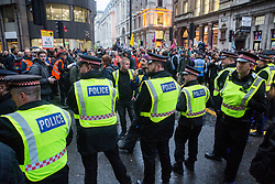 London, UK. 14 October, 2019. City of London Police officers bar the route to London Bridge to climate activists from Extinction Rebellion who had vacated the busy junction in front of the Bank of England after occupying it 7am on the eighth day of International Rebellion protests.