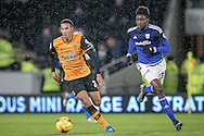Isaac Hayden (on loan from Arsenal) (Hull City) turns away from Sammy Ameobi (on loan from Newcastle United) (Cardiff City) during the Sky Bet Championship match between Hull City and Cardiff City at the KC Stadium, Kingston upon Hull, England on 13 January 2016. Photo by Mark P Doherty.