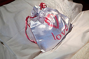 Love bag on a honeymoon bed