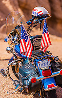 A Harley-Davidson motorcycle parked along the Camino del Rio (along the Rio Grande River, which is the border of the USA and Mexico), Big Bend Ranch State Park, Texas USA.