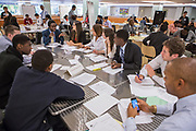 Purchase, NY – 31 October 2014. The Woodlands High School team discussing their case study. Woodlands High School went on to place second in the 2014 competition. The Business Skills Olympics was founded by the African American Men of Westchester, is sponsored and facilitated by Morgan Stanley, and is open to high school teams in Westchester County.