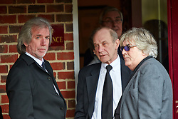 © Licensed to London News Pictures.  14/02/2013. BASINGSTOKE, UK. Original Troggs band members Dave Maggs (left), Chris Britton (centre) and Peter Lucas (right) pay their respects during the funeral of Reg Presley at Basingstoke Crematorium. The lead singer of 1960s rock band The Troggs, who became famous with hits including Wild Thing, died aged 71 earlier this month. Photo credit: Cliff Hide/LNP