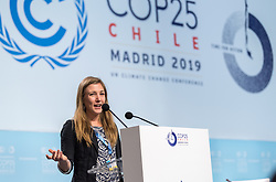 2 December 2019, Madrid, Spain: Lutheran World Federation delegate Erika Rodning from Canada takes the opporunity to stand at the podium during one of the breaks on day one of COP25 in Madrid.